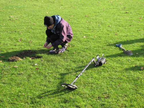 metal detector unearthing