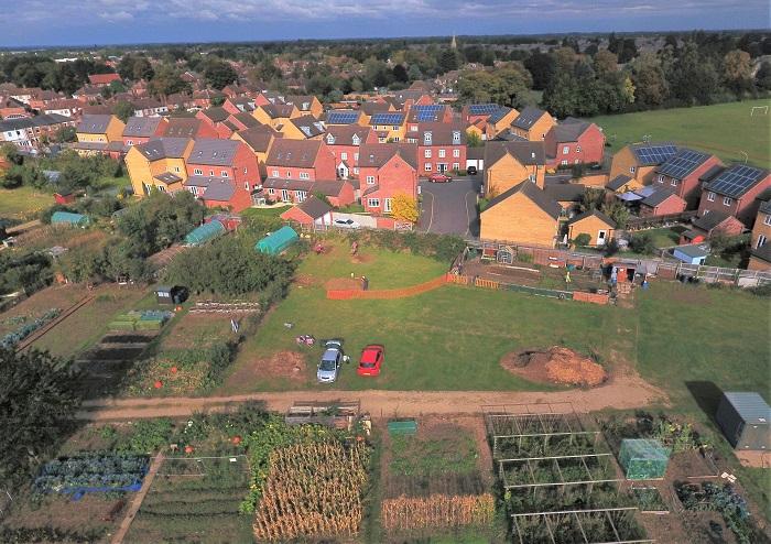 View north over villa site to Paston Church